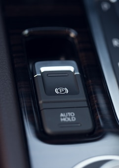 Close-up shot with the detail of a parking brake in a car