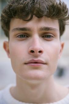 Close up shot young man staring