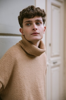Close up shot young man with turtleneck