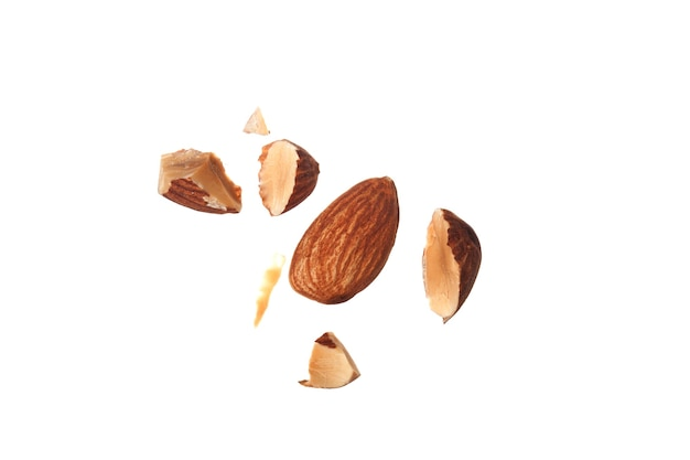 Close up shots of almonds isolated on white background.