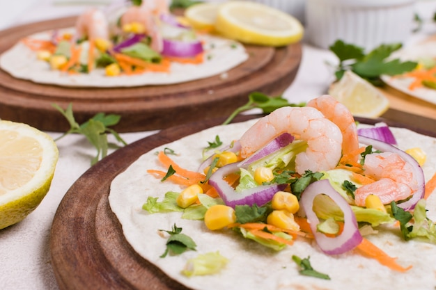 Close-up of shrimp and other food on pita