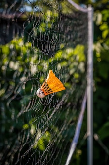 Close up of shuttlecocks struck on the net outdoor for sport background