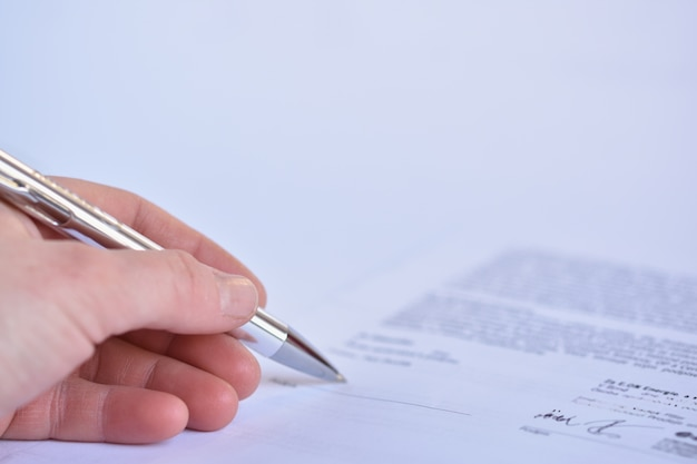 Close-up of the signing of a contract