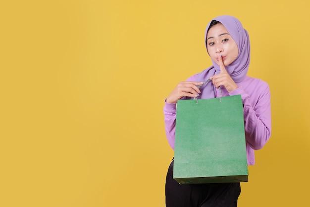 Close up silently beautiful asian shopaholic women holding shopping bags