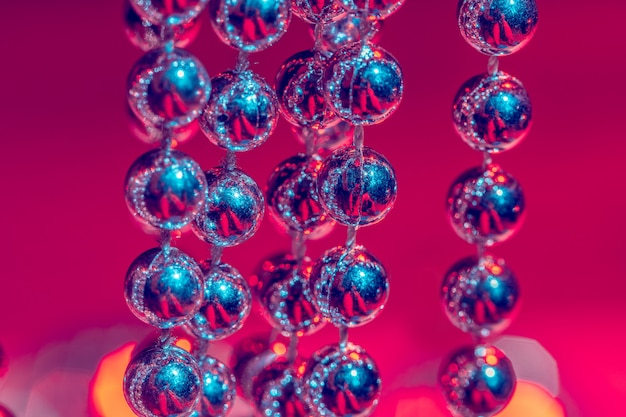 Close up of silver beads. christmas and holiday decoration concept
