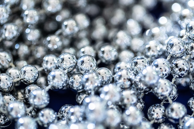 Close up of silver beads, christmas and holiday decoration concept