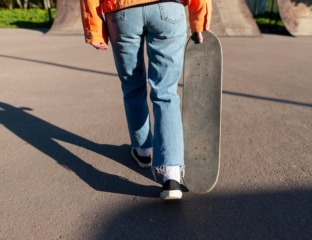 Close up skater carrying board