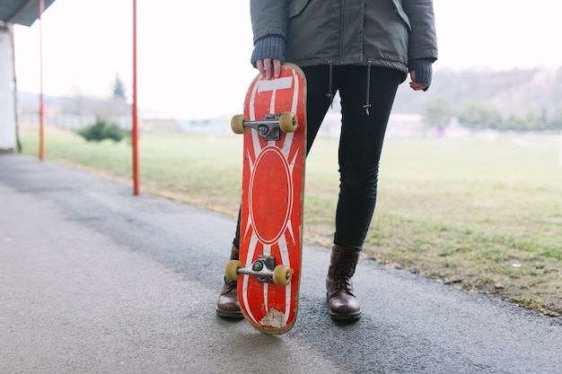 Close-up of skater with skateboard in the park