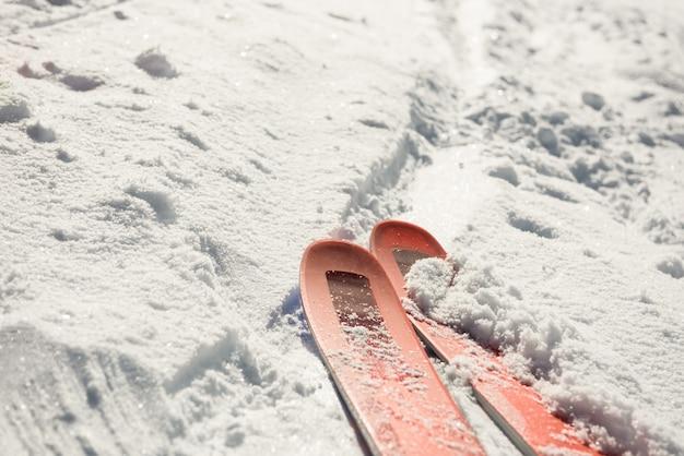 Close-up of ski on snowy landscape