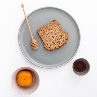 Close-up slice of bread on plate with honey