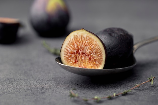 Close-up of sliced fig on spoon