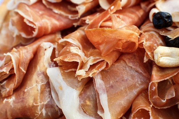 Close up sliced fresh rolls of jamon