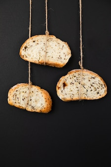 Close-up slices of bread tied with rope
