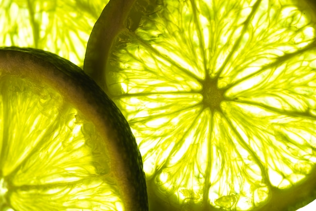 Close-up slices of lime in sunlight