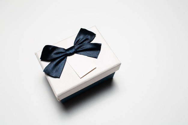 Close-up of small gift box with bow isolated.