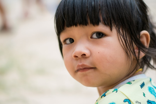 Close up smile asian child girl face
