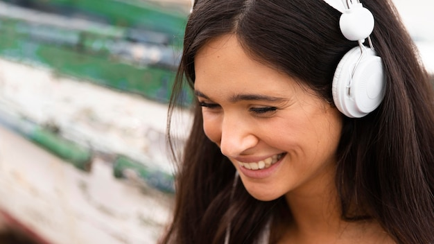 Close-up smiley girl with headphones