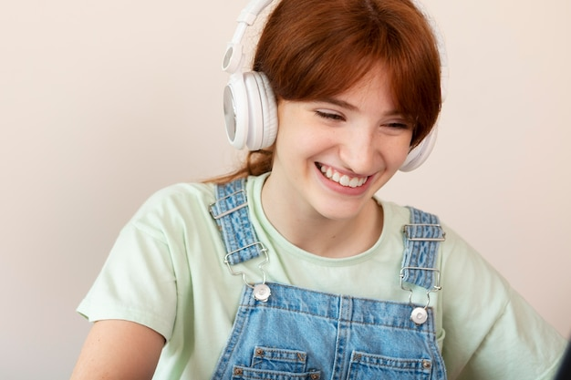 Close up smiley girl with headphones