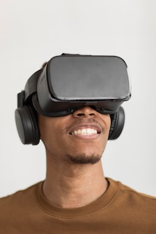 Close up smiley man with vr glasses