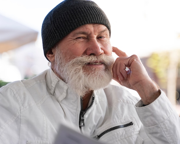 Close up smiley old man outdoors
