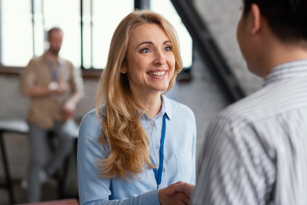 Close up smiley woman talking to man