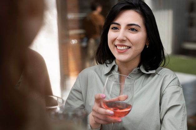 Close up smiley woman with wine glass