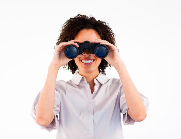 Close up of smiling businesswoman looking through binoculars