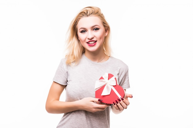 Close-up of smiling female holding red heart shaped giftbox