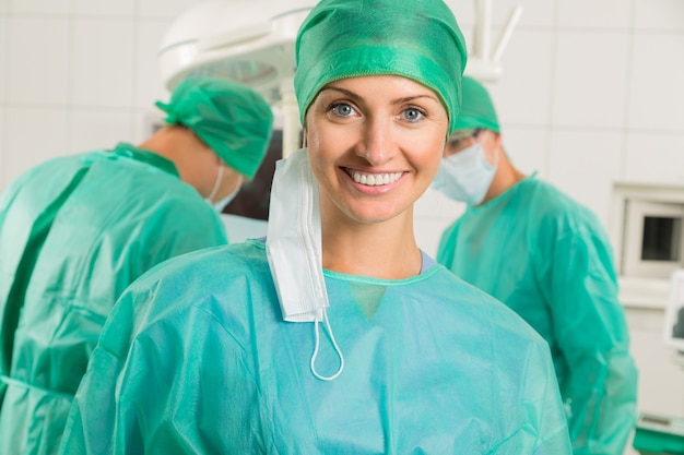 Close-up of a smiling nurse , doctor standing in an operating room