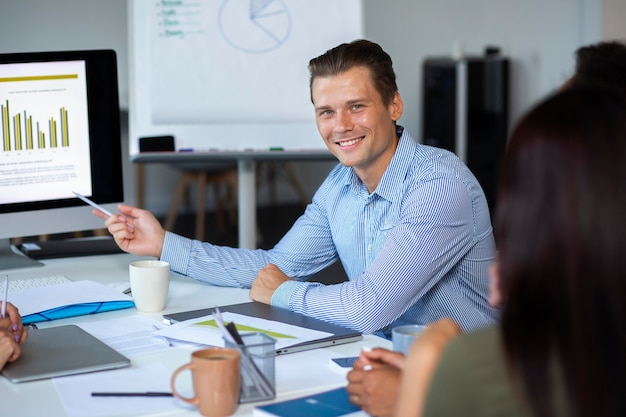 Close up on smiling person in conference room