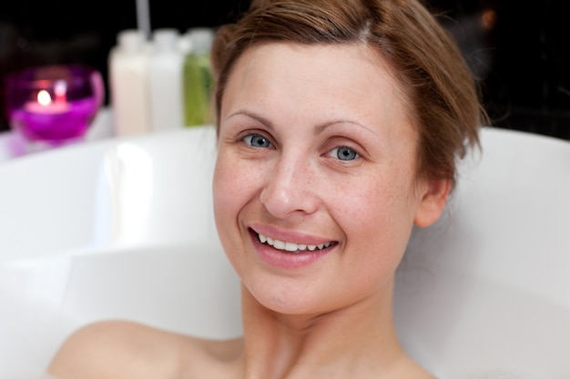 Close-up of a smiling woman having a bath