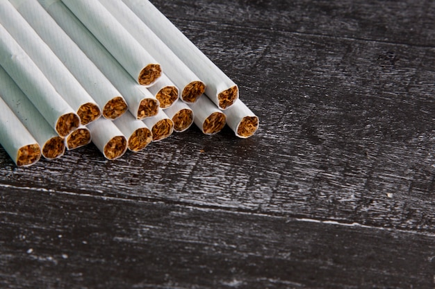 Close-up of smoking cigaretted on a dark background