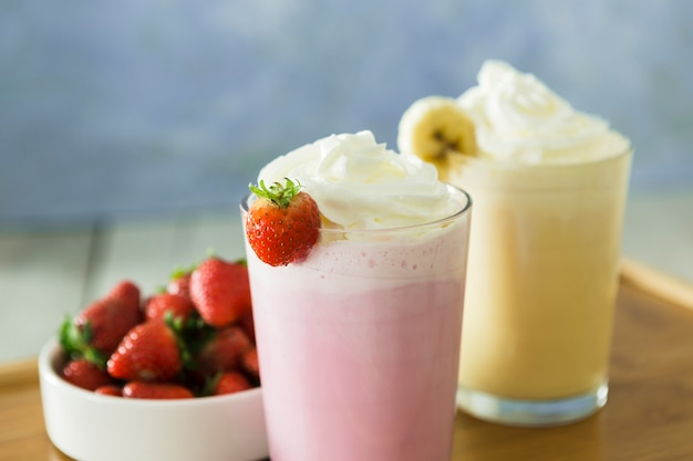 Close-up of smoothies with banana and strawberry