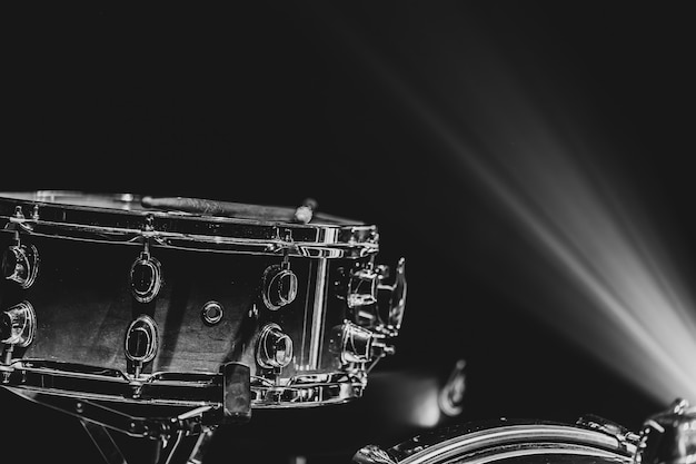 Close-up of a snare drum, percussion instrument on a dark background with beautiful lighting, copy space.