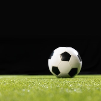 Close-up soccer ball on the pitch