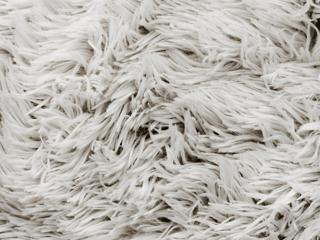 Close-up of soft white rug backdrop