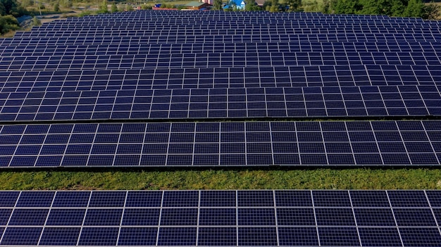 Close up solar power station panels in a row in the fields green energy