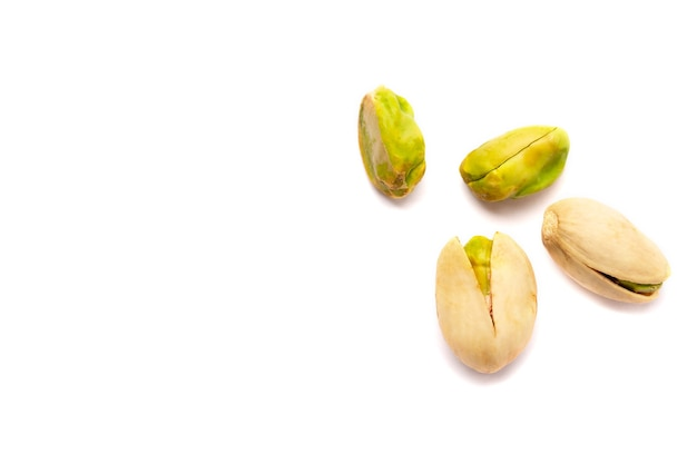 Close up on some pistachio nuts isolated
