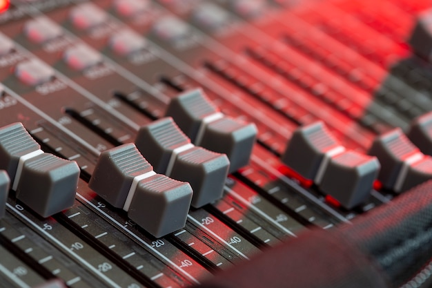Close up sound mixer in studio