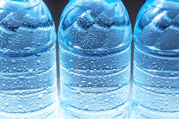 Close up of a sparkling water bottle with condensation on it