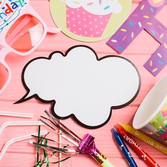 Close-up speech balloon near party supplies