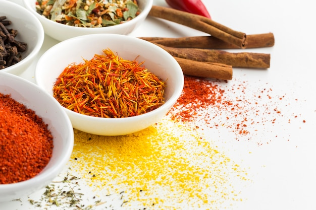 Close-up spice powder and herbs on table
