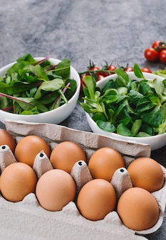 Close-up of spinach and eggs in the carton