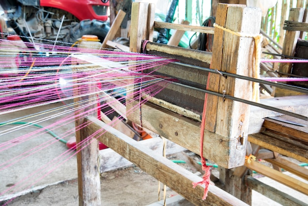 Close up spinning production line. spinning wood handmade with spindles  yarns