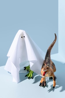 Close-up spooky halloween ghost and dinosaur toys