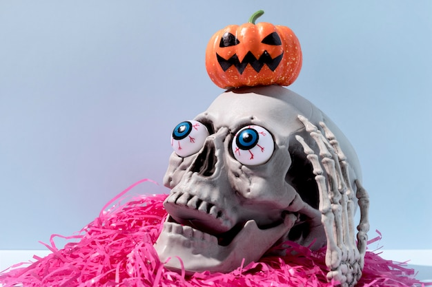 Close-up spooky halloween skeleton with confetti