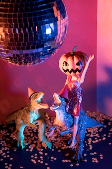 Close-up spooky halloween toys and disco ball
