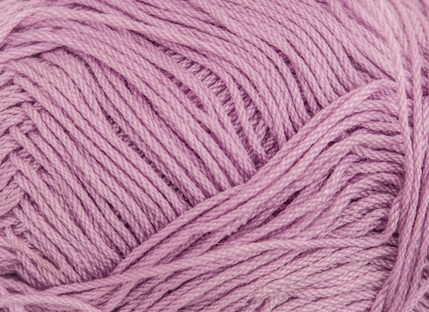 Close up of a spool of cotton pink thread