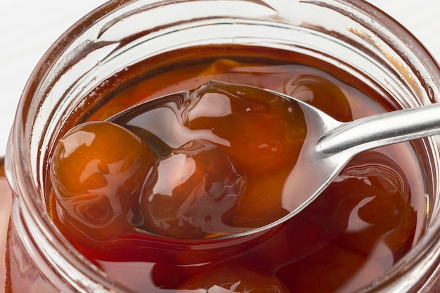Close-up spoon in jam jar
