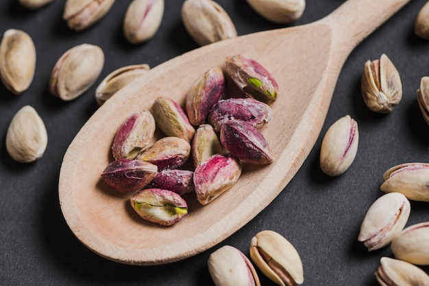 Close-up spoon with peeled pistachios